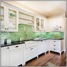 blue green glass subway tile backsplash bath