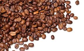 Background In The Form Of A Handful Coffee Beans On White