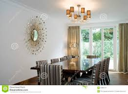 Chandelier Over Dining Room Table by Chandelier Over Dining Table And Art On Wall Stock Image Image
