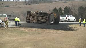 Dump Truck Carrying Asphalt Overturns On Interstate 90