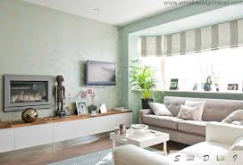 Living Room With Fireplace In The Middle by Middle Size Living Room Color Ideas