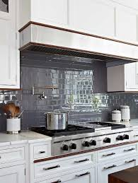 gray subway tiles with white cabinets transitional kitchen