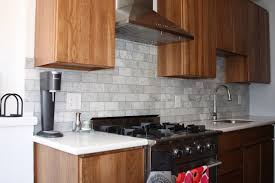 Kitchen Astounding Design Ideas With Light Brown Solid Wood Cabinet Rectangular Grey Tile Backsplash And White Laminate