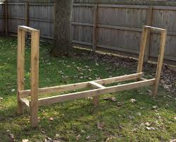 Simple DIY Outdoor Firewood Rack In The Backyard With Green Grass
