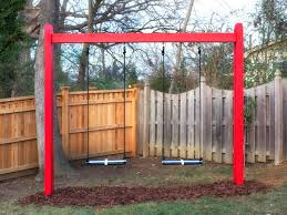 Outdoor : A Wooden Swing With Red Color And Then A Wooden Fence ... Outdoor Play With Wooden Climbing Frames Forts Swings For Trees In Backyard Backyard Swings For Great Times Chads Workshop Swing Between 2 27 Stunning Pallet Fniture Ideas Youll Love Beautiful Courtyard Garden Swing Love The Circular Stone Landscaping Playful Kids Tree Garden Best 25 Small Sets Ideas On Pinterest Outdoor Luxury Trees In Architecturenice Round Shaped And Yellow Color Used One Rope Haing On Make A Fun Ground Sprinkler Out Of Pvc Pipes A Creative Summer