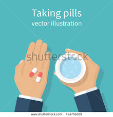 Taking the pills Man holds in hands the capsule and a glass of water