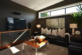 Black Leather Sofa Decorating Ideas by Interior Wall Decor Ideas For Family Room Features Dark Brown