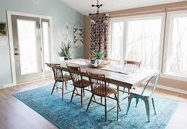 Dining Room With Blue Rug And Chairs