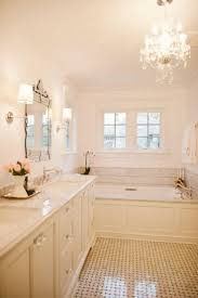 Chandelier Over Bathtub Soaking Tub by Classic Chic Home In Chicago Master Bathrooms Natural Light And