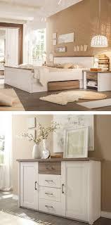 schlafzimmer mit kommode und bett im landhaus design