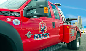 100 Grizzly Trucks Asset Recovery Repossession Services Parking Enforcement