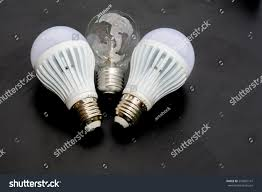 new energy saving light bulb on stock photo 557887141