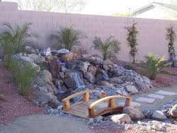 Backyard : Amusing Brown Wooden Bridge And Water Stream From Rock ... Diy Backyard Stream Outdoor Super Easy Dry Creek Best 25 Waterfalls Ideas On Pinterest Water Falls Trout Image With Amazing Small Ideas Pond Pond Stream And Garden Plantings In New Garden Waterfall Pictures Waterfalls Flowing Away 868 Best Streams Images Landscaping And Building Interesting Joans Idea For Rocks Against My Railroad Ties Beautiful Yard 32 Feature Design Design Waterfall Ponds Call Free Estimate Of