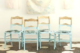 beautifully dipped bare wood kitchen chairs in baby blue light