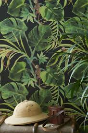 A Fun Green Jungle Leaf Wallpaper Design Set On Coloured Background With Mischievous Monkeys
