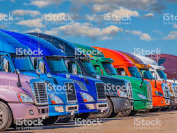 100 Simi Trucks Semi In Many Colors Are Lined Up In Texas Stock Photo
