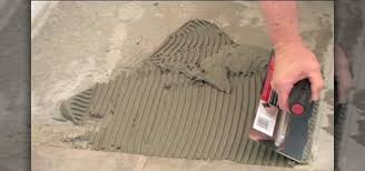 Tiling A Bathroom Floor On Concrete by How To Install Ceramic Tile On Concrete Using Thinset Mortar