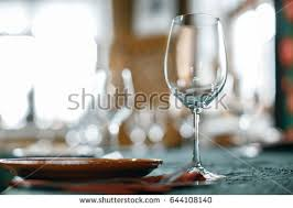 Wine Glasses And Table Serving In Rustic Style Restaurant