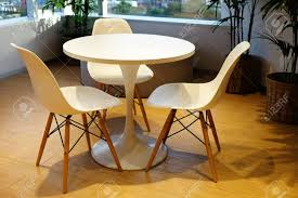 White Round Table And Three Comfortable Chairs At The Corner.. Cowhide Lounge Chair Auijschooltornbroers Yxy Ding Table And Chairs Tempered Glass Splash Proof Easy Clean Steel Frame Man Woman Home Owner Family Elegant Timeless Simple Euro Western Design Oversized Large Folding Saucer Moon Corduroy Round Stylish Room Interior Comfortable Stock Photo Curve Backrest Hotel Sofa With Ottoman Factory Sample For Sale Buy Used Salearmchair Ottomanround Slacker Sack 6foot Microfiber Suede Memory Foam Giant Bean Bag Black Ivory Faux Fur Papasan Cushion White By World Market Cordelle Swivel Gray A2s Protection Joybean Fniture Water Resistant Viewing Nerihu 780 Capo Product