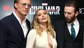 Was Chris Evans Caught Staring At Elizabeth Olsens Breasts Captain America Civil War Premiere
