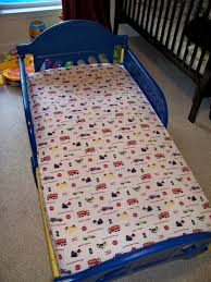 Spray paint plastic toddler bed We did this with a plastic