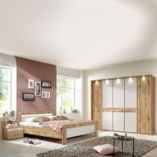 wiemann donna 2 schlafzimmer mit bett 5 türigem drehtürenschrank und nachtkonsolen in balkeneiche nachbildung mit absetzungen in chagner dekor