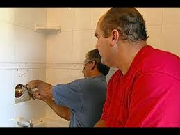 how to repair a shower valve in a tile wall this house