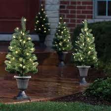 Pre Lit Entryway Christmas Trees by The Cordless Prelit Pathway Trees Hammacher Schlemmer