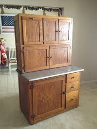 hoosier cabinet put dishes silverware and pots n pans away in