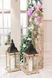 Rustic Wood Lantern And Gold Birdcage Beside Ceremony Arch Toronto Wedding Flowers Decor At