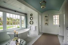 Guest Bathroom Wall Decor With Three Framed Paintings Near Sliding Window Also Freestanding Bathtub