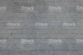 Closeup Surface Brick Pattern At Old Black Stone Floor Pathway Texture Background Royalty