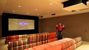 custom home theater with drop down projector screen masking and