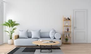 graues sofa und kissen im weißen wohnzimmer premium foto