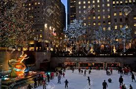 Rockefeller Plaza Christmas Tree by Ice Skaters And The Famous Rockefeller Center Christmas Tree