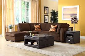 nice yellow living room with yellow wall paint and brown sectional
