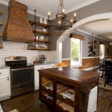 Open Kitchen And Dining Space United By Similar Wood Trim