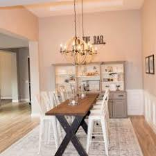 Neutral Country Dining Room With Rug