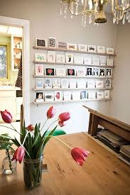 20 Cool Ideas To Display Unframed Photo And Postcards On Walls