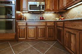 brown kite shape tile floor combined with brown wooden kitchen