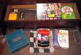 Lot 154 Of 448 Games Giant Cloth Checkers Board Skip Bo Taboo Last Word Trivial Pursuit Genius Edition TV Guides Game Vintage Risk And More