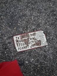 two toynbee tiles near lexington market new baltimore boy