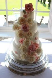 Floral Rose Cascade Wedding Cake In Pink And Ivory At The West Retford Hotel By