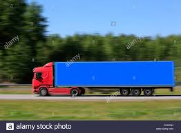 Blue Green Semi Truck Motion Stock Photos & Blue Green Semi Truck ...