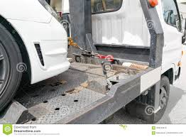 Car Towed Onto Flatbed Tow Truck With Hook And Chain Stock Photo ...