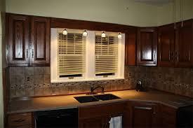 light above kitchen sink ideas trendyexaminer
