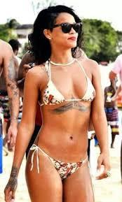 RKellys 19 Year Old Girlfriend Got Same Chest Tattoo As Rihanna