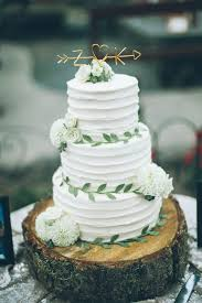 The Sweetest Tree Trunk Wedding Cake With Adorable Golden Topper
