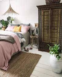 I Love A Beautiful And Uncomplicated Bedroom The Pink Layered Bedding Painted Wood Planked Floors That Gorgeous Intricate Armoire Are My Jam