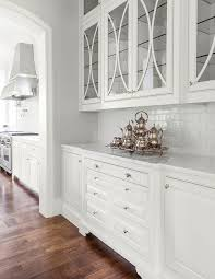 white butler pantry with glossy white subway tiles transitional